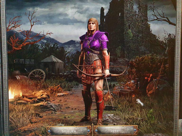 Ein Spielcharakter aus Diablo 2 in kunterbunter Rüstung und mit einem Bogen.